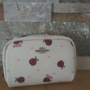 Coach mini lady bug print cosmetic bag.